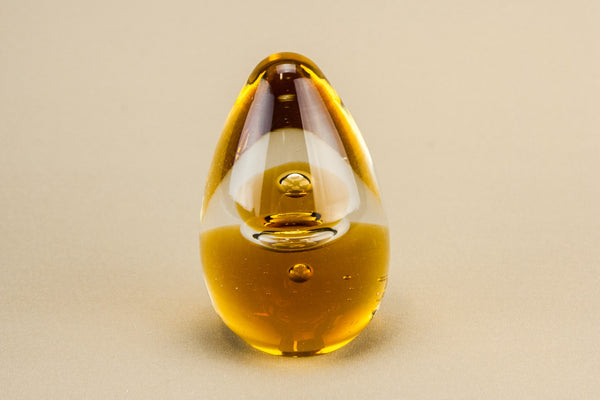 Amber glass paperweight