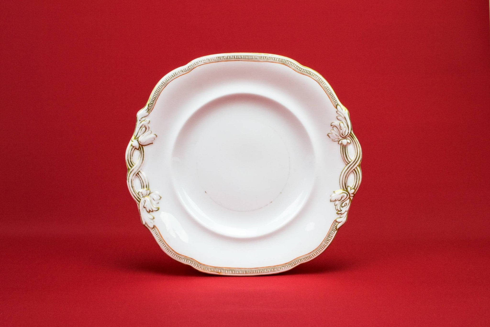 Gold and white serving plate