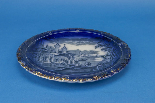 Flow blue serving plate