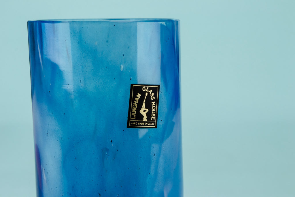 Small blue glass vase