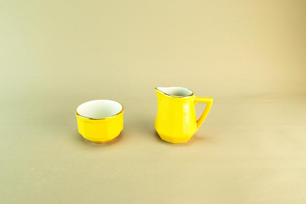 Revol yellow creamer and sugar bowl
