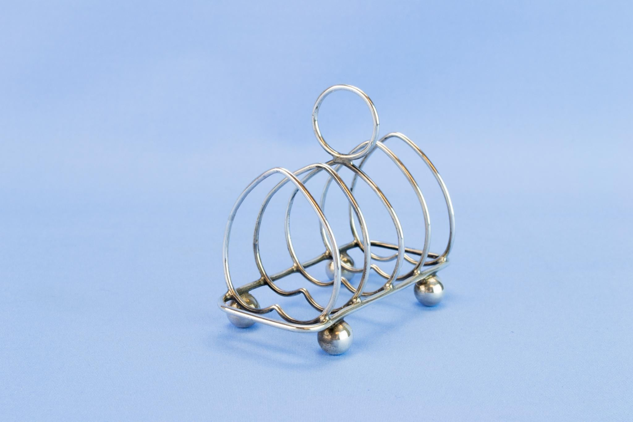Arts & Crafts sterling silver toast rack, 1914