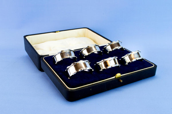6 sterling silver napkin rings, 1926