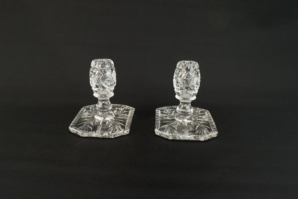 Pair of cut glass small candlesticks