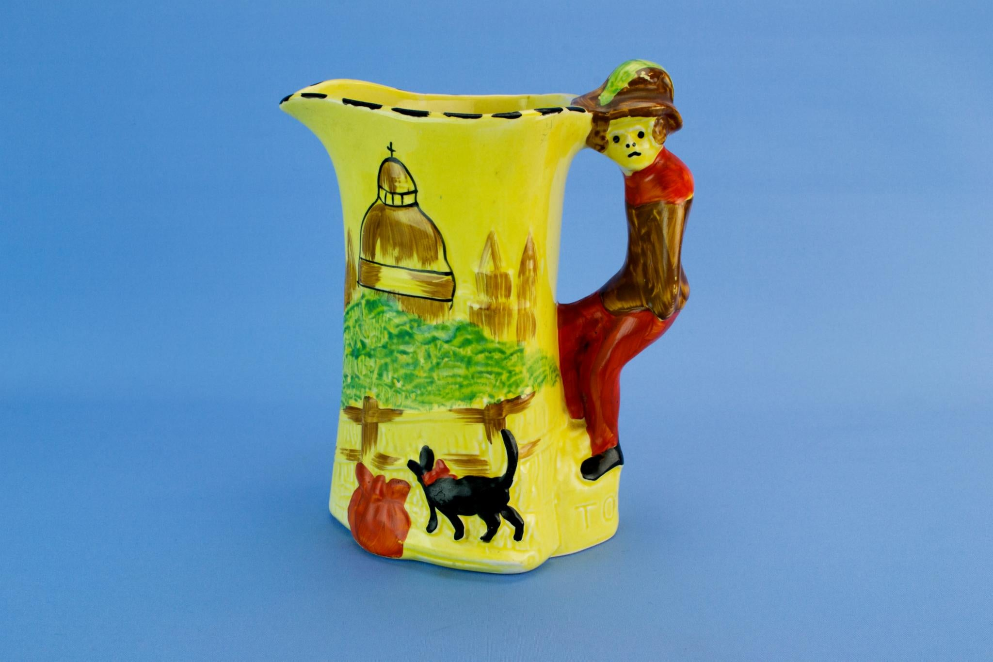 Dick Whittington yellow jug, English 1930s