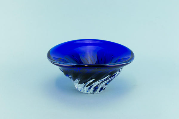 Blue glass decorative swirl bowl