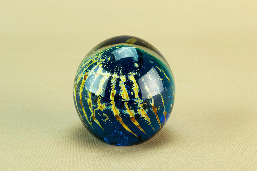 Blue globular glass paperweight