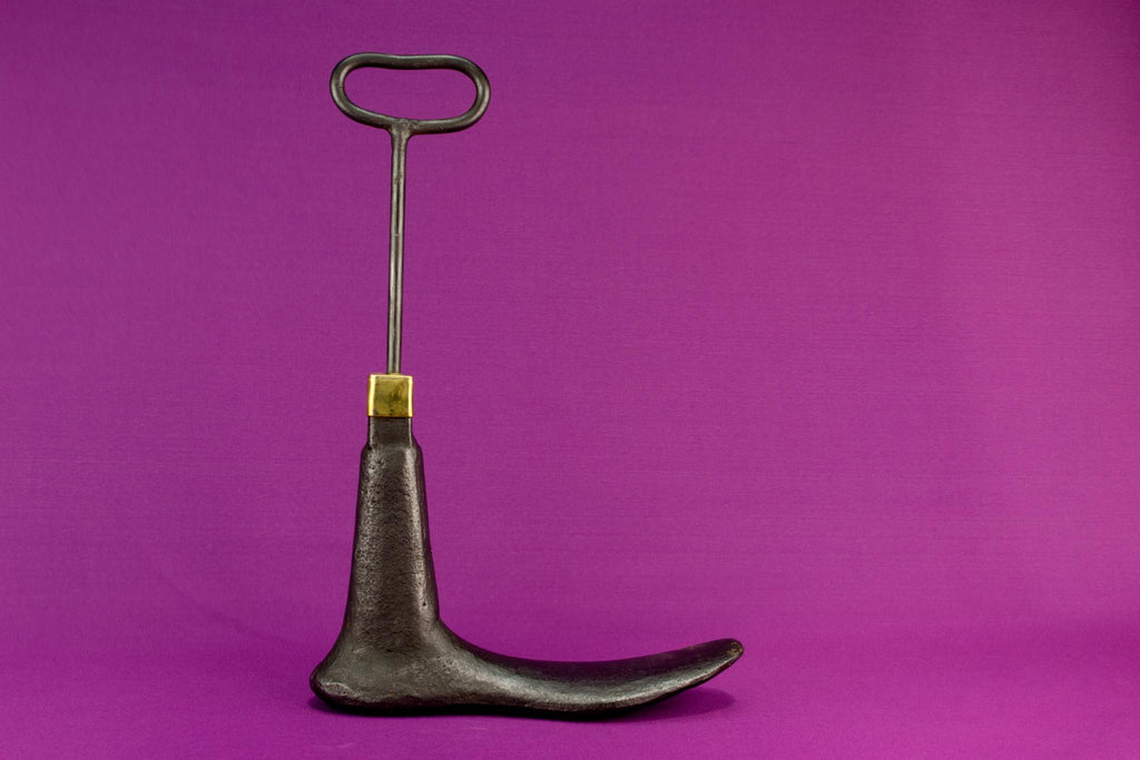 Boot shaped iron door stopper with a handle