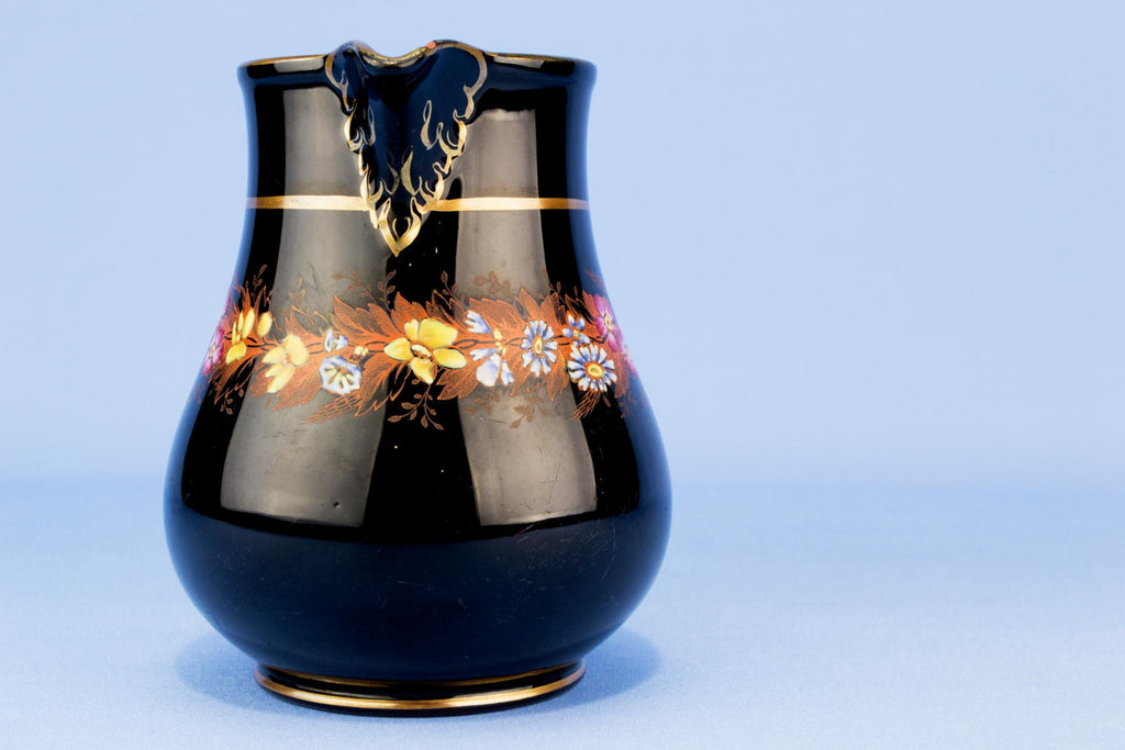Medium black floral water jug, English 19th century