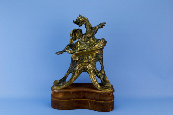 Winged seahorse brass door stopper, English 19th century