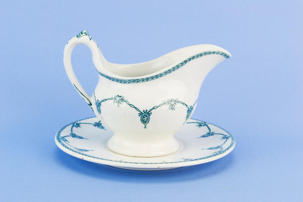 Blue and white gravy boat on plate, English 1920s