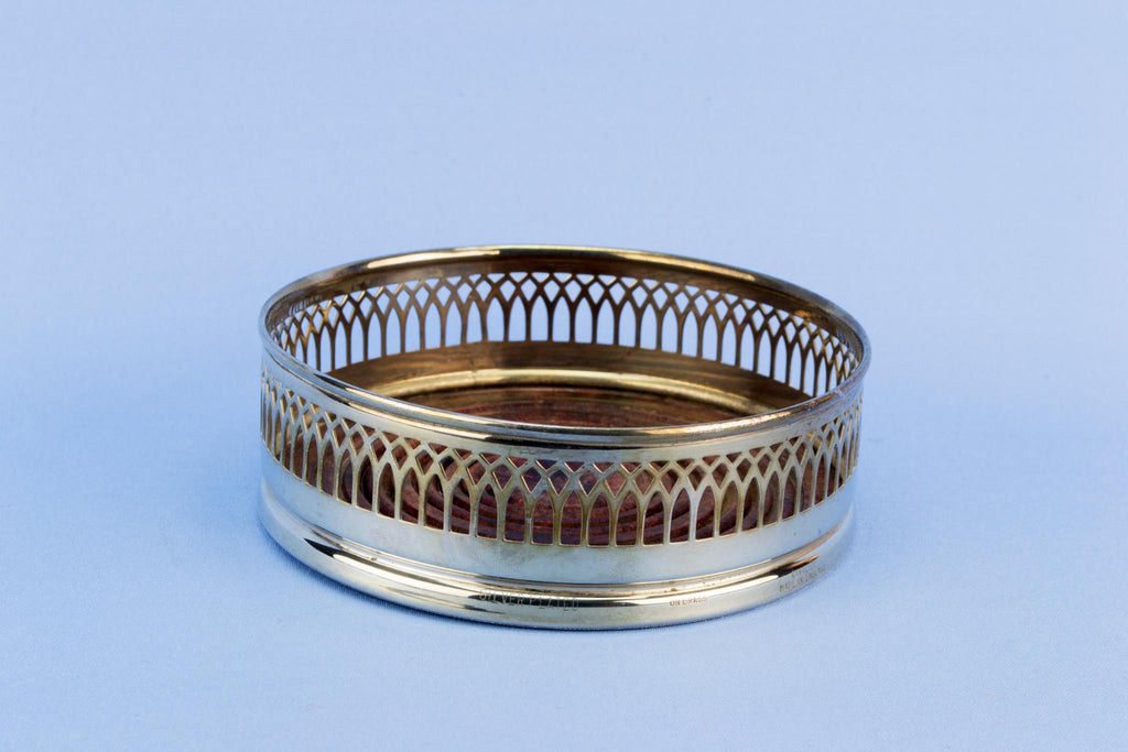 Silver plated bottle coaster, English mid 20th century
