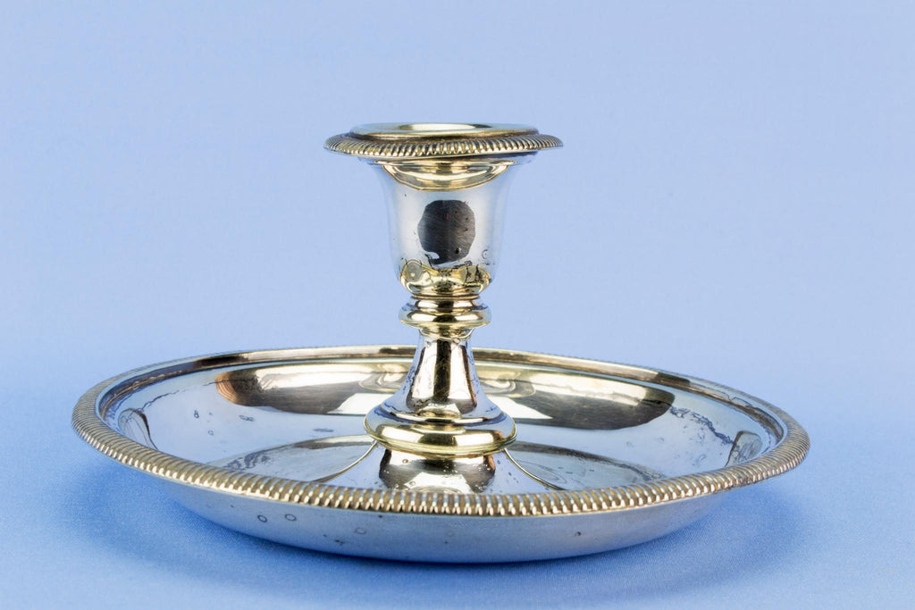 Silver plated table candlestick on a wide base, English early 1900s