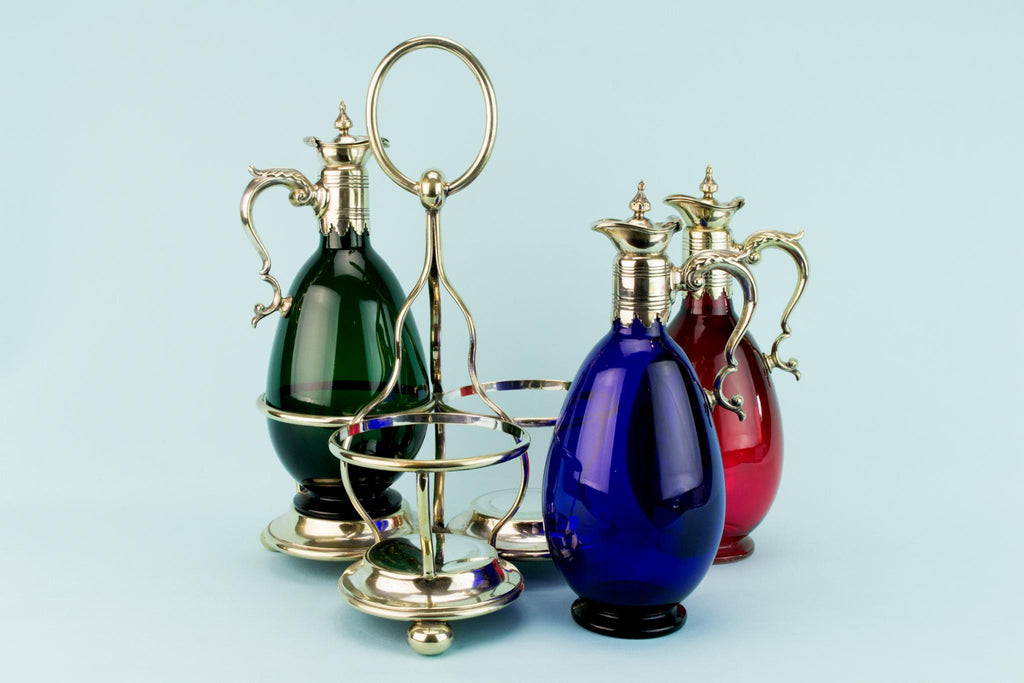 Three Colourful Decanters Set on a Stand, English 19th Century