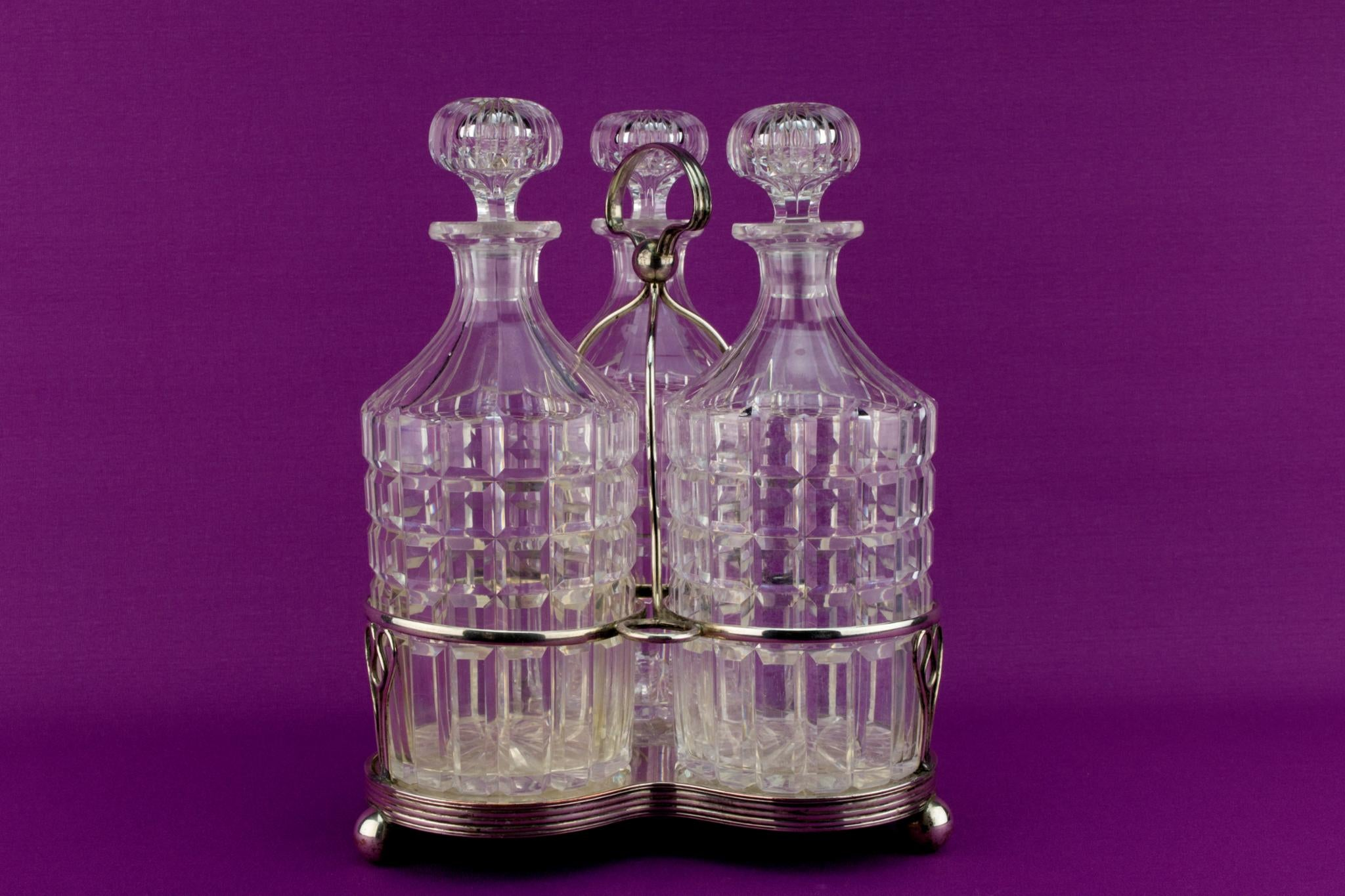 3 Glass decanters on stand, English Early 1900s
