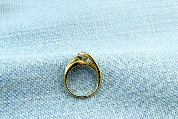 Diamond Ring in 9ct Gold Flower Bezel