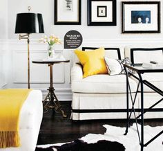 Monochrome living room with a splash of yellow