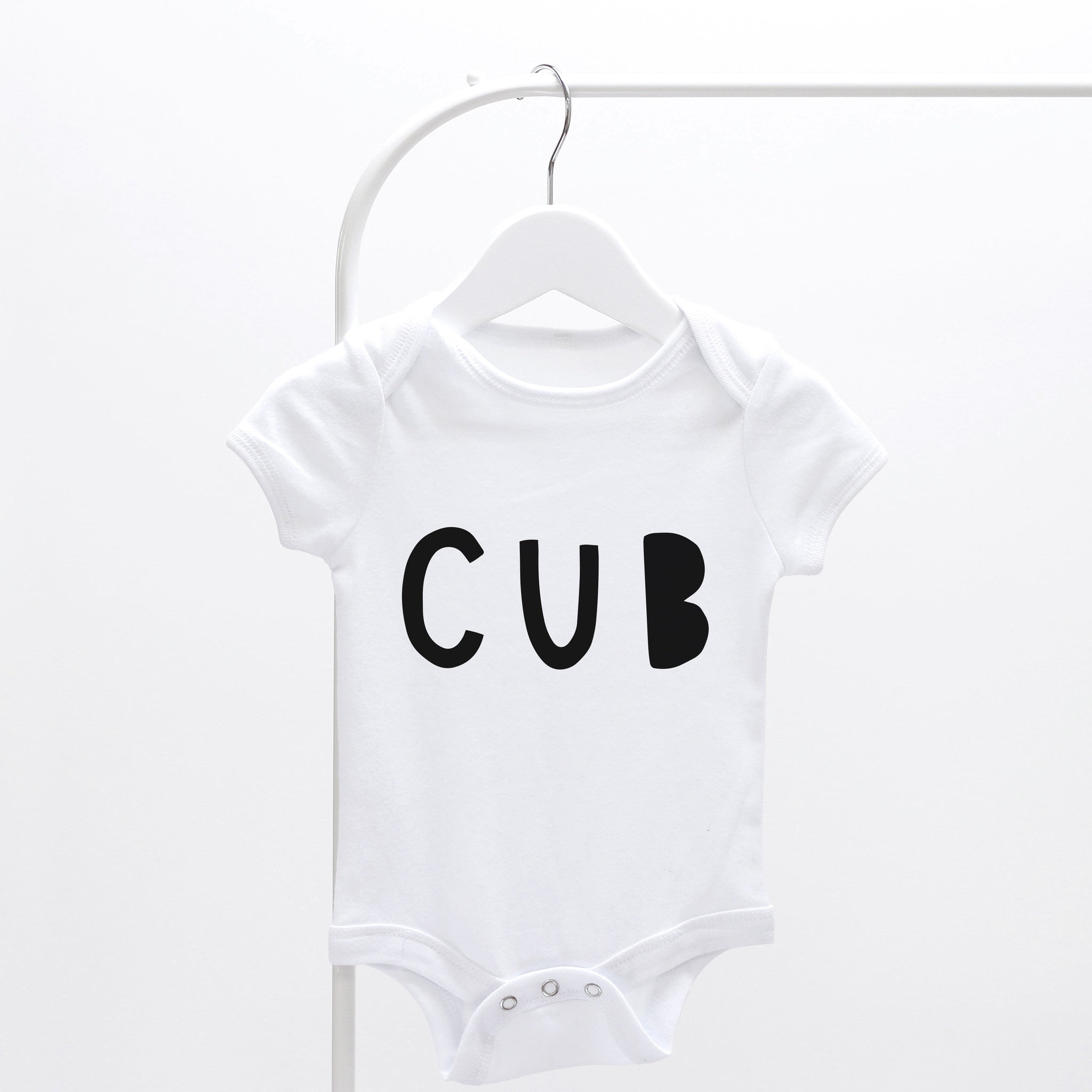 hand lettered cub baby grow