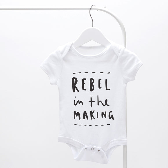 rebel in the making nursery print baby grow