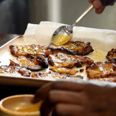 Smashed plantain coated with Trini Pepper Sauce
