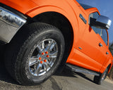 ColorLugs orange colored lug covers on silver truck wheel