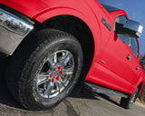 ColorLugs red colored lug covers on silver truck wheel