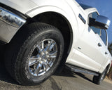 ColorLugs white colored lug covers on silver truck wheel