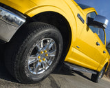 ColorLugs yellow colored lug covers on silver truck wheel
