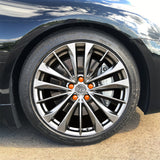 ColorLugs orange colored lug covers on silver automobile wheel
