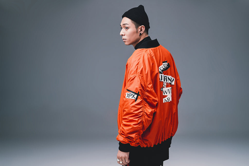 XPX PATCH PRINT BOMBER JACKET IN ORANGE