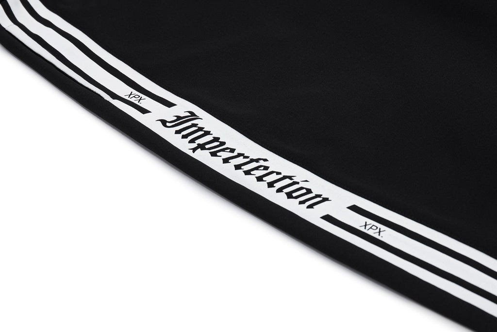 XPX 'IMPERFECTION' BUTTON TRACK PANTS
