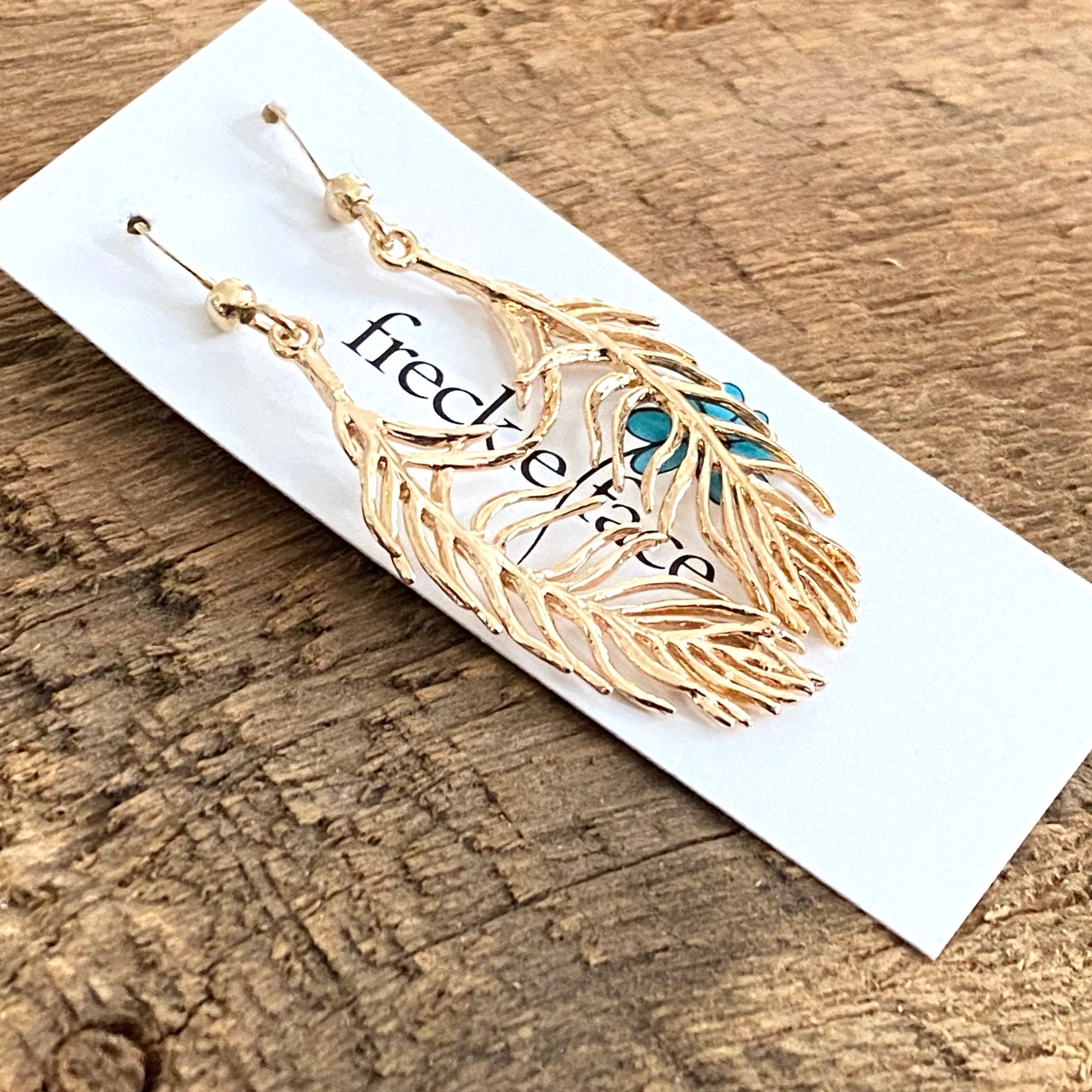 Delicate gold feather earrings