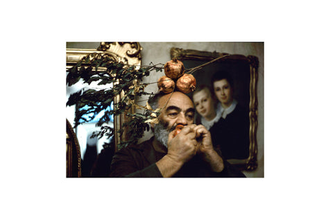 print - Sergei Paradjanov by Yuri Mechitov. Improvised self-portrait with pomegranates