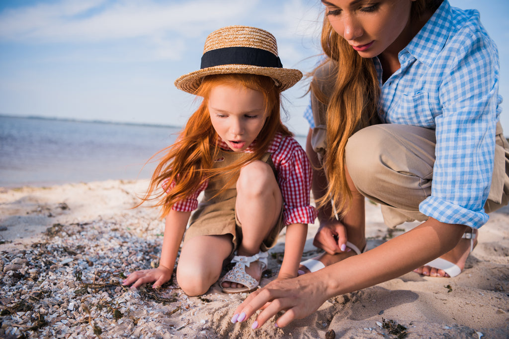 girl, mom, hunting for seashells, sea glass,