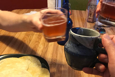 enjoying homemade cider with friends