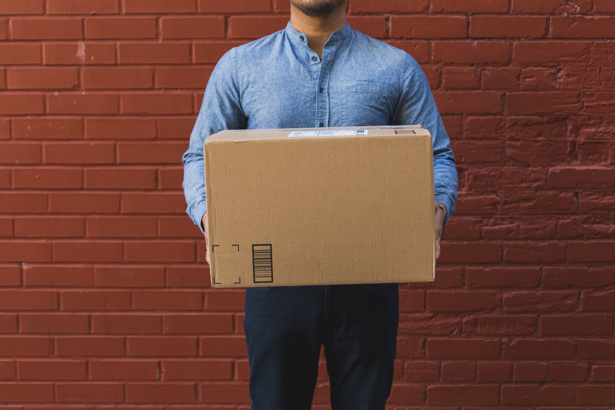 man with shipping box