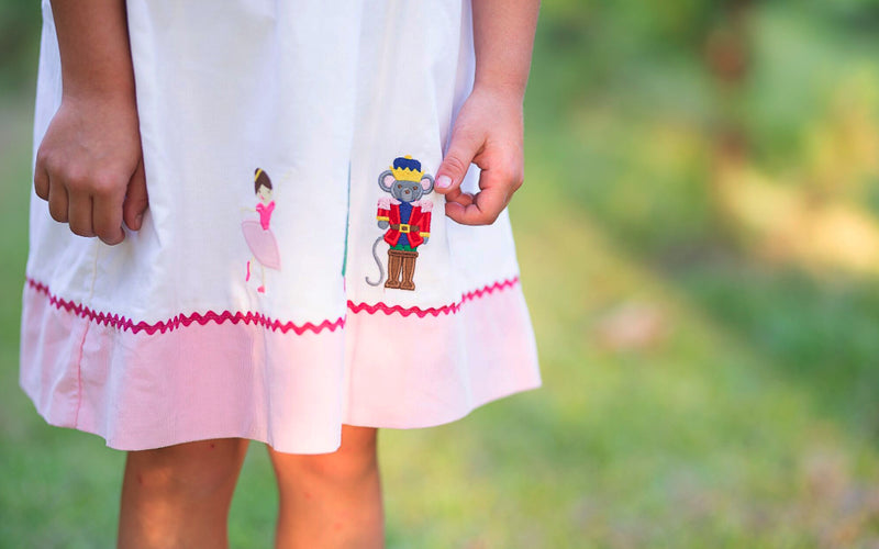 Nutcracker appliqued off white and pink cord dress - Little Threads Inc. Children's Clothing