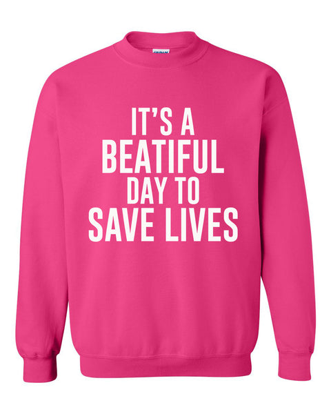 It's a beatiful day to save lives Crewneck Sweatshirt