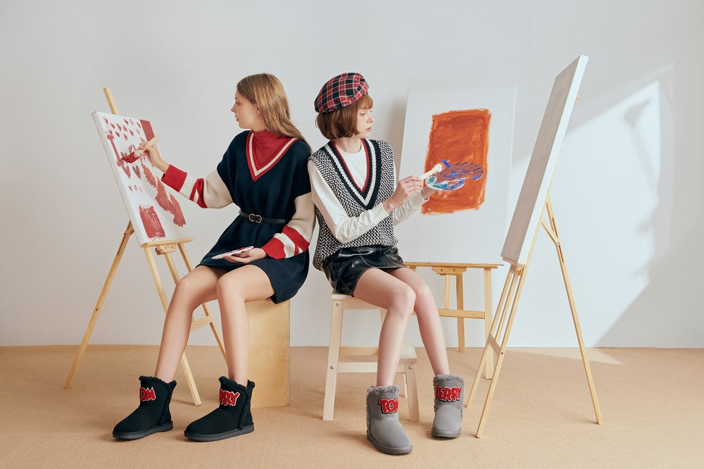 girls painting in their tom & jerry ugg boots