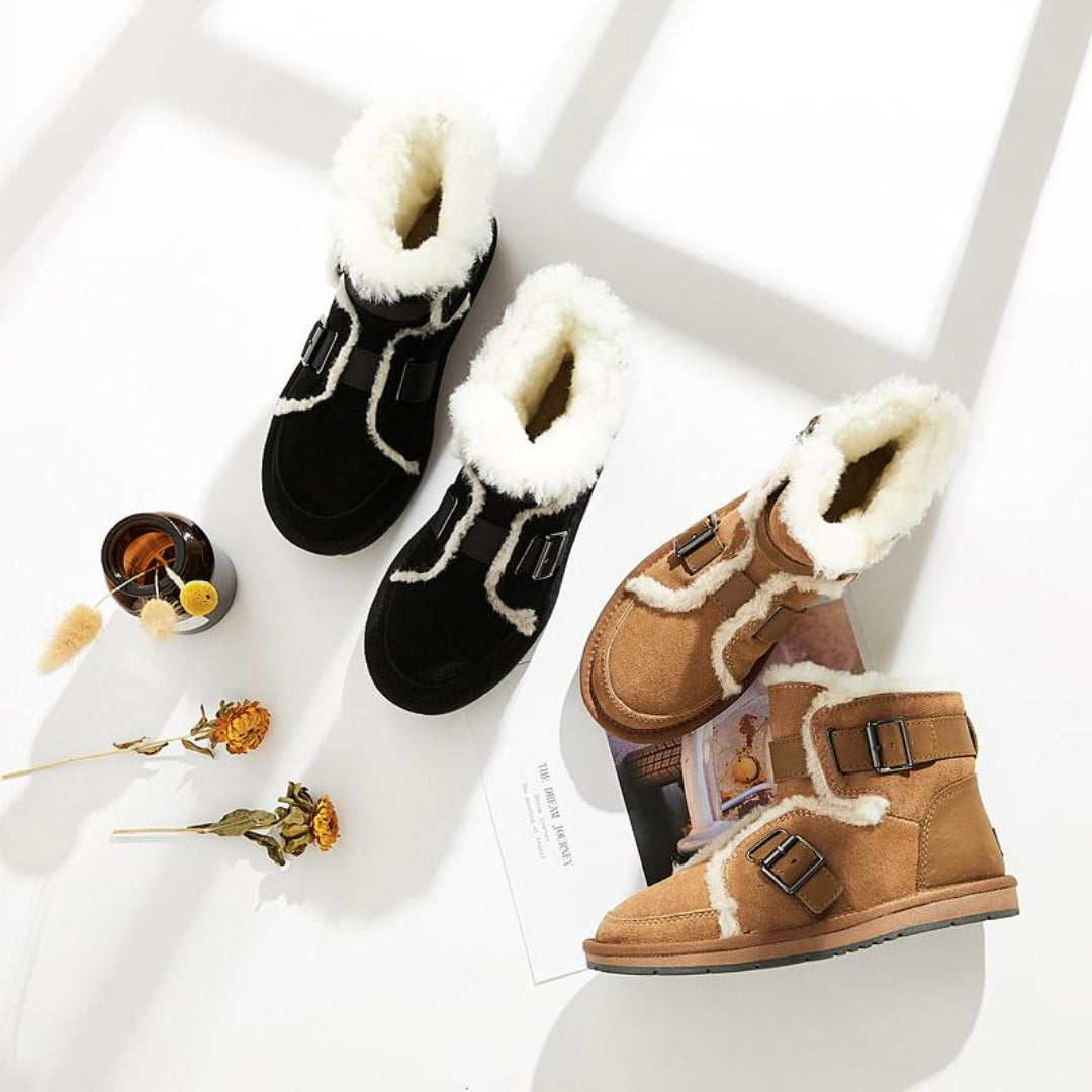 sheepskin lined boots in black and brown