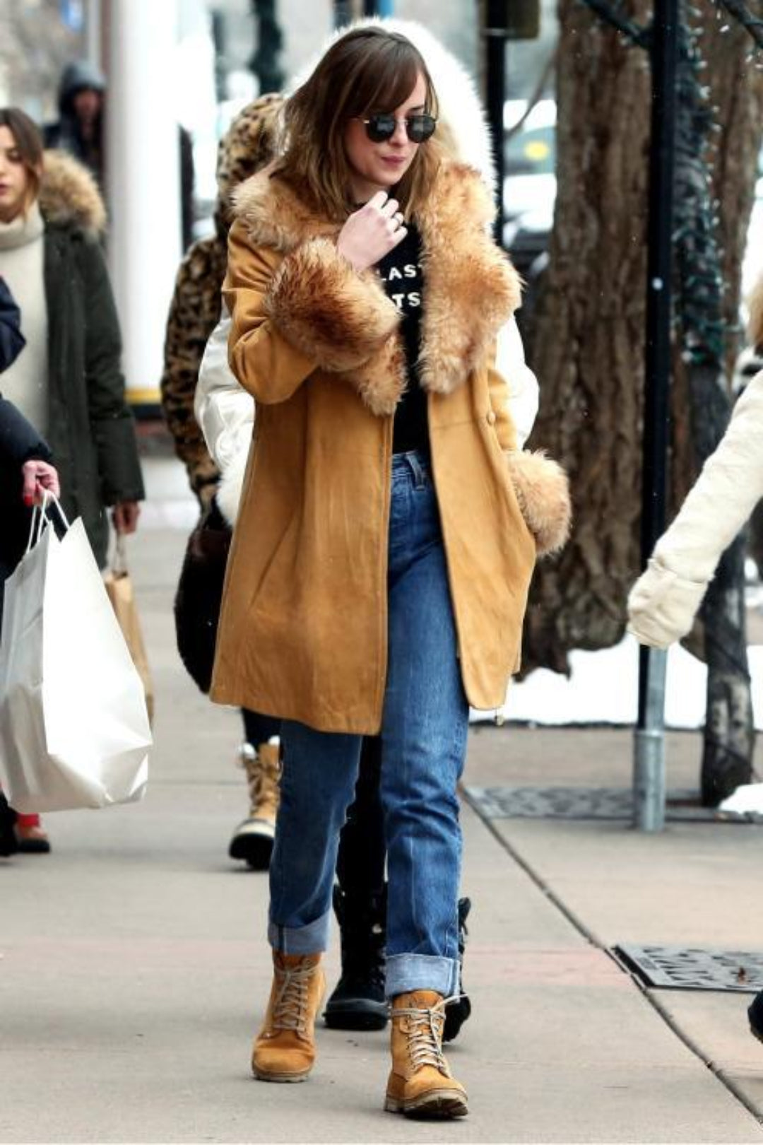 actress dakota johnson in camel combat boots