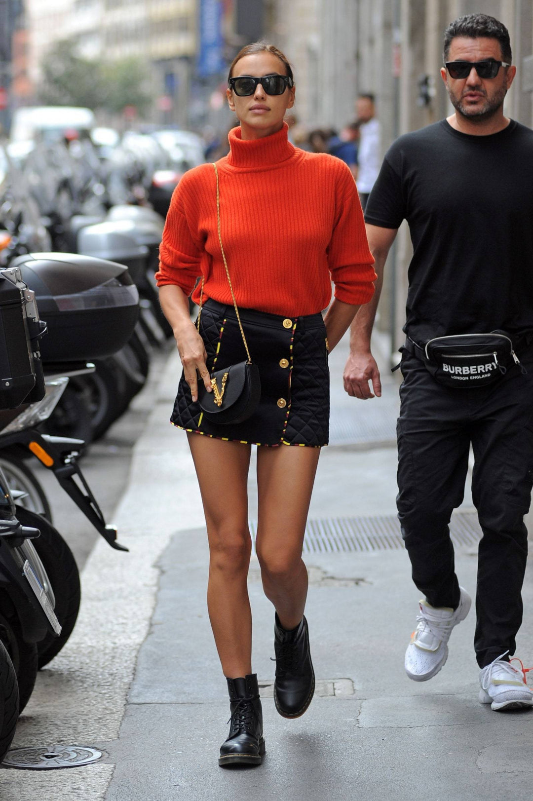 model irina shayk wearing combat boots with jumper
