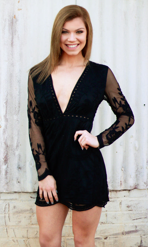 black lace dress with plunging neckline