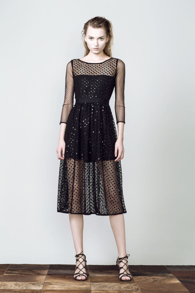 SONIA H black diamond dress, is in a classic and easy to wear silhouette. The cut-work pattern, sheer texture and black sequins bring out a subtle sparkling look, classy and stylish. The drapness of the fabric brings out nice movement when worn in motion.