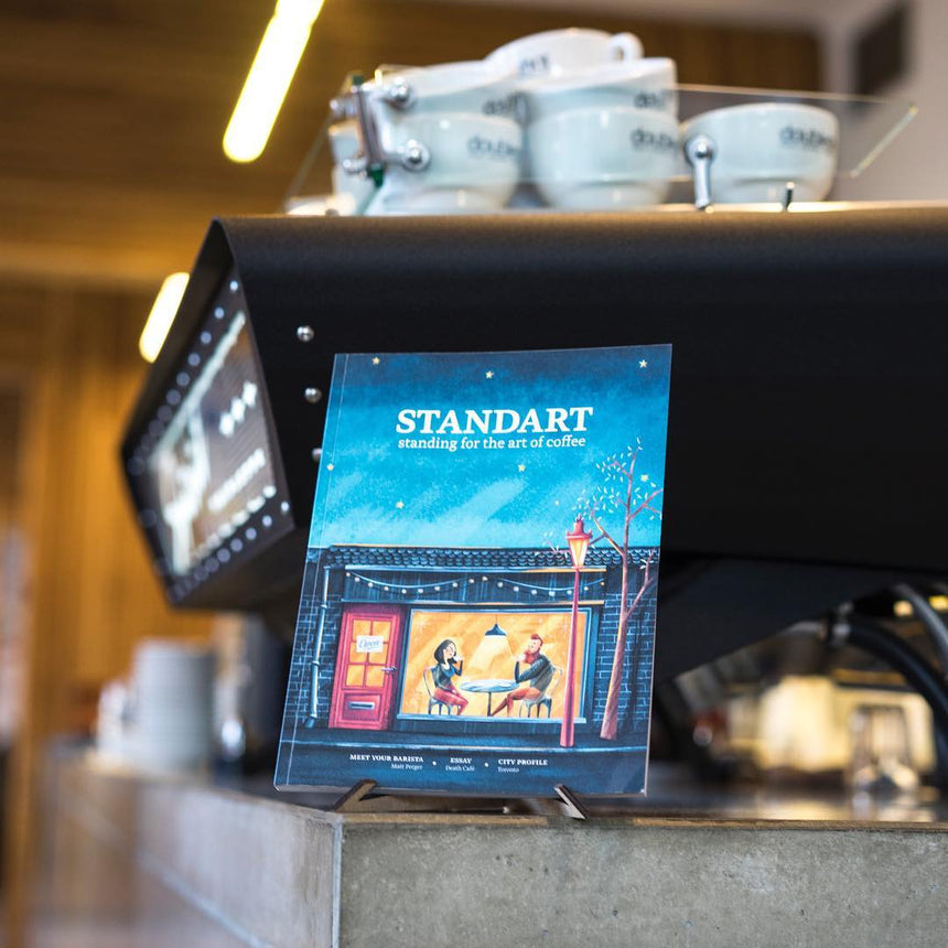 Standart magazine in front of a coffee machine in a speciality coffee shop