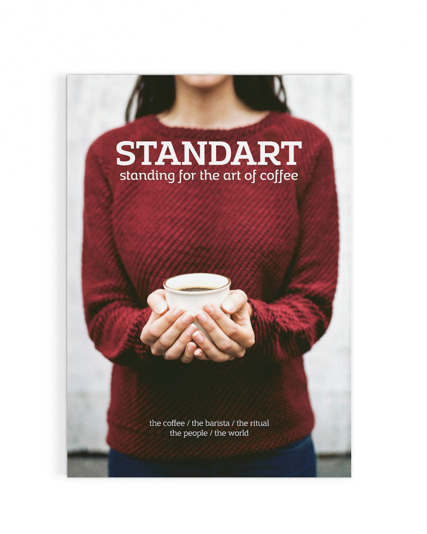 Woman holding coffee on the cover of Standart magazine, issue 1