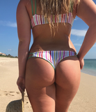 sexy and cute rainbow bikini bottoms on girl at the beach