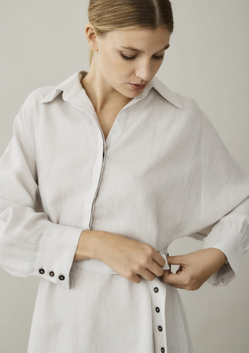 off white linen shirt dress showing optional button tie belt