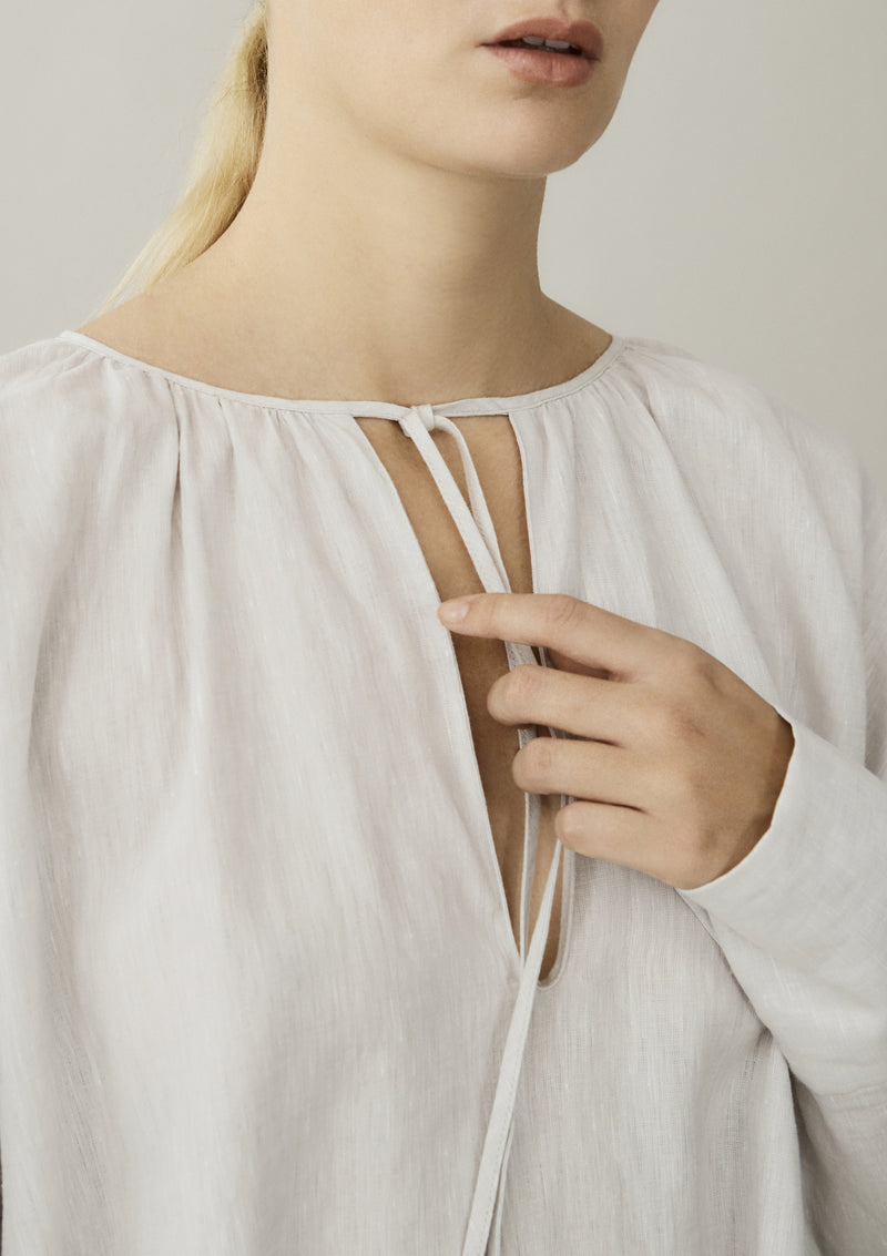 off white linen dress with tie neckline