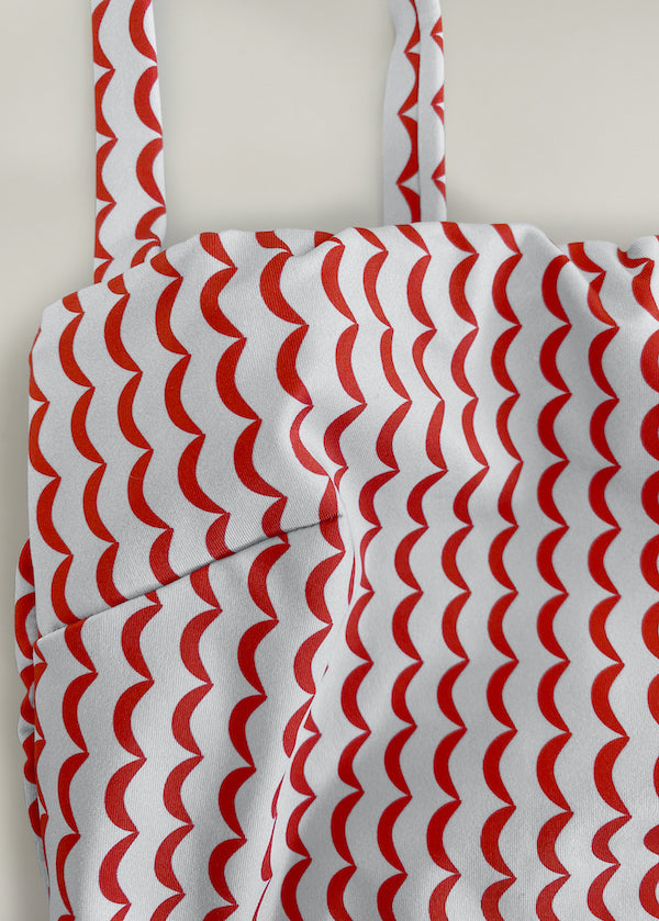 Red and cream crescent print swimsuit with thin straps